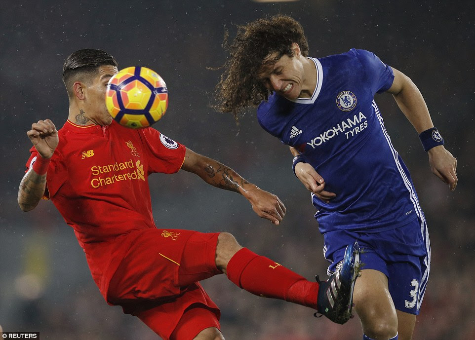 Former Paris Saint-Germain defender Luiz was busy in the first half - here he is beating Firmino to the ball at Anfield
