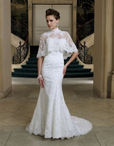 Lace bridal poncho over lace wedding gown by David Tutera