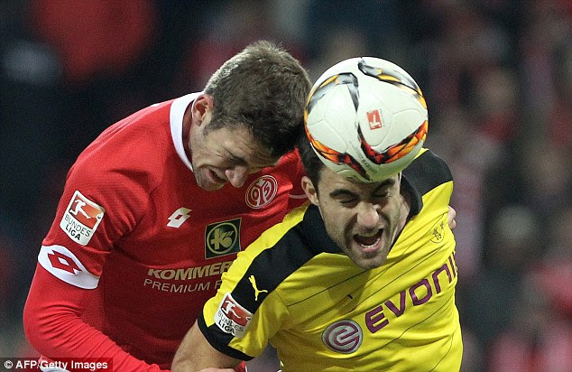 Dortmund defender Sokratis (right) and Mainz defender Stefan Bell contest an aerial battle