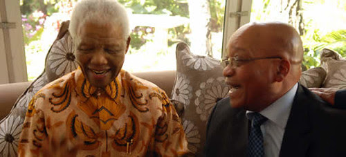 Former South African President Nelson Mandela and current President Jacob Zuma enjoy a laugh at Madiba's 91st birthday celebration on July 18, 2009. by Pan-African News Wire File Photos