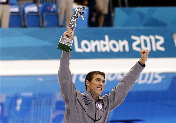 On August 4, 2012, Michael Phelps poses with a special trophy recognizing him as the greatest Olympian of all time...with 22 career medals.