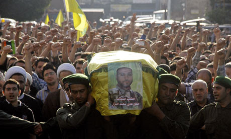 Members of Lebanon's Hezbollah carry coffin