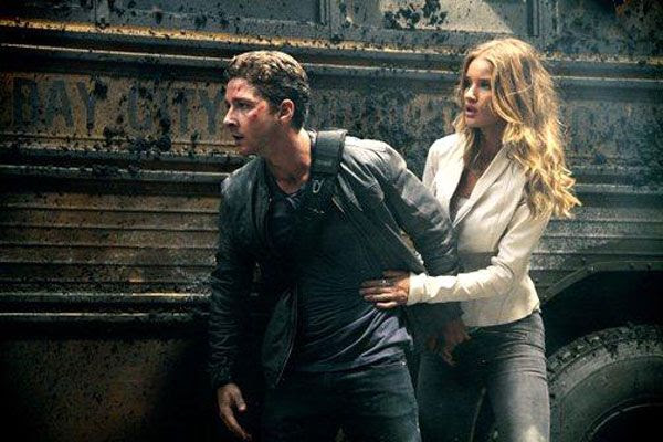 Shia LaBeouf and Rosie Huntington-Whiteley watch out for danger in TRANSFORMERS: DARK OF THE MOON.