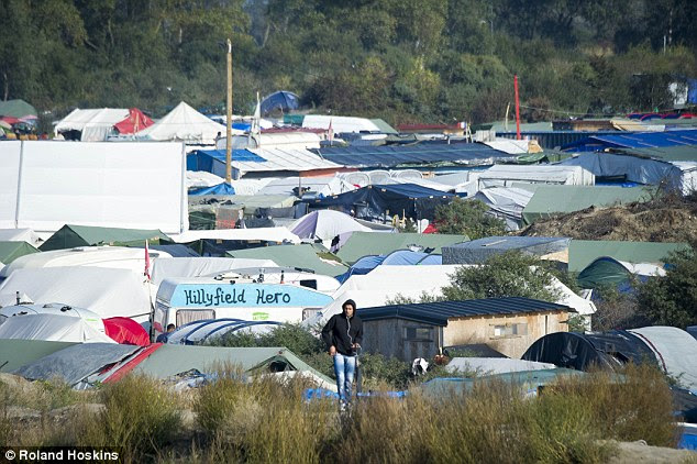 They are being moved from the Jungle camp, pictured, ahead of its impending demolition by French authorities