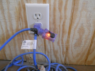 Extension Cord Inside Showing Power
