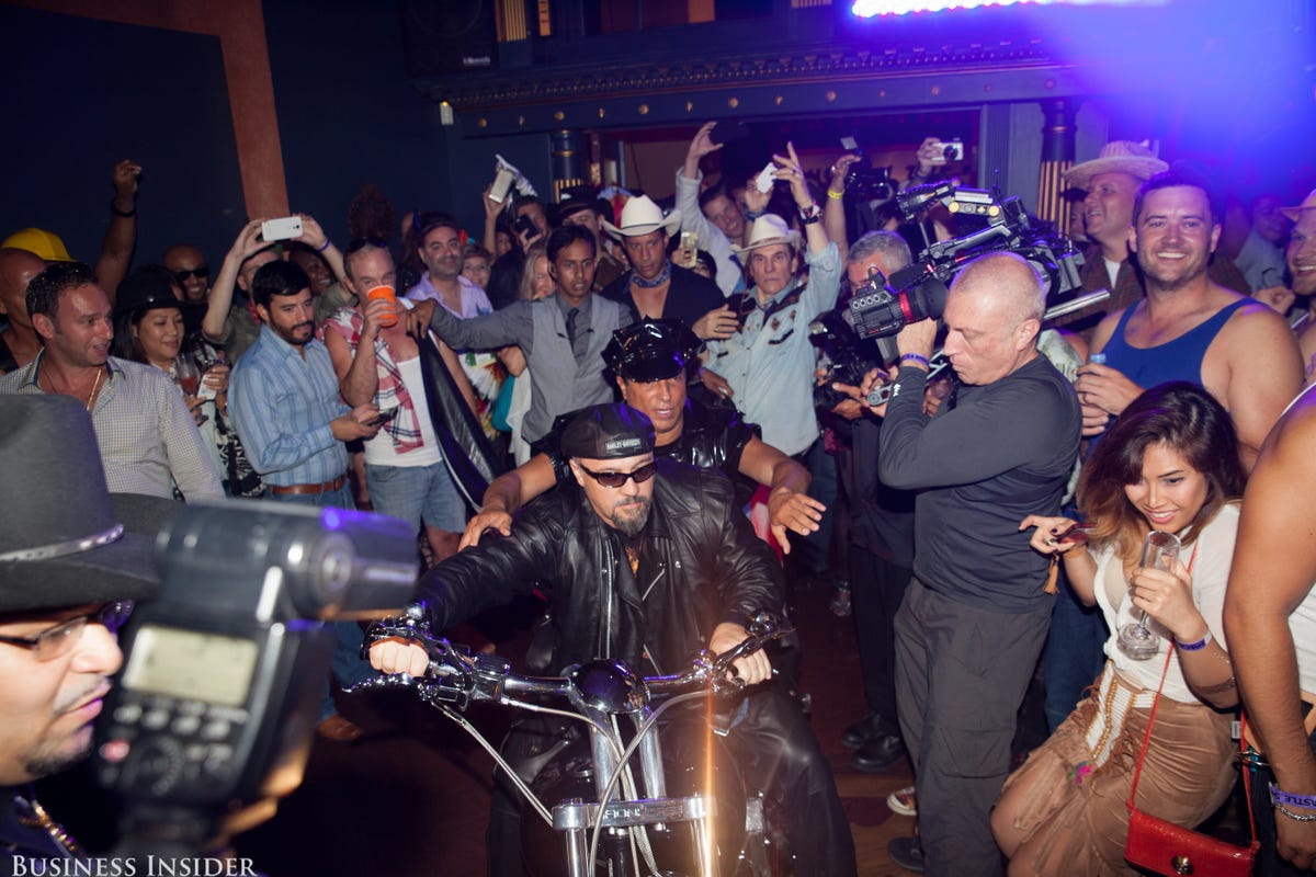 Finally, Sir Ivan arrived on a motorcycle — the crowd was excited to finally see the host.