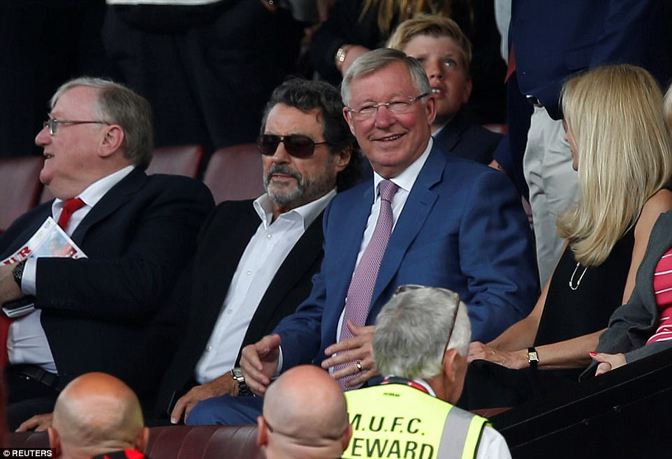 Former Manchester United manager Sir Alex Ferguson takes his seat in the directors' box before the match at Old Trafford