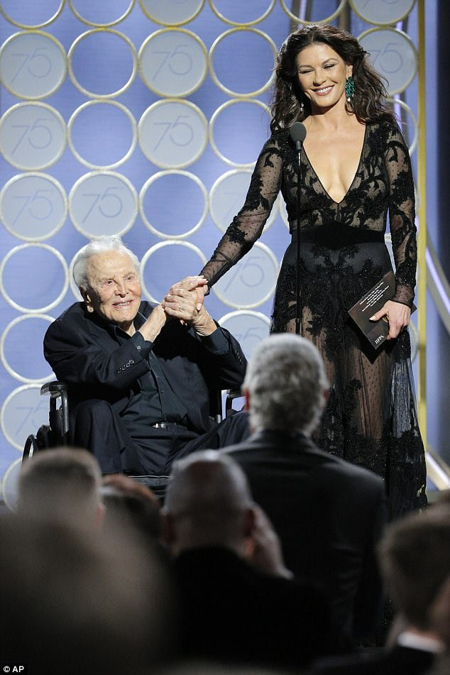 Together: Catherine looked delighted to join her father-in-law Kirk on stage to present an award at the envy-inducing Golden Globes evening
