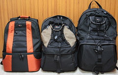 Three Lowepro's 2 or 3 compartment backpacks (...