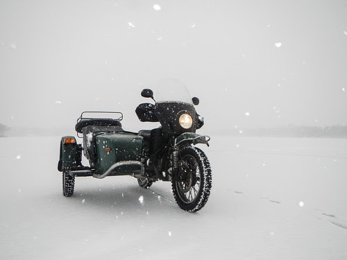 Ural on Frozen Lake in Snow Storm