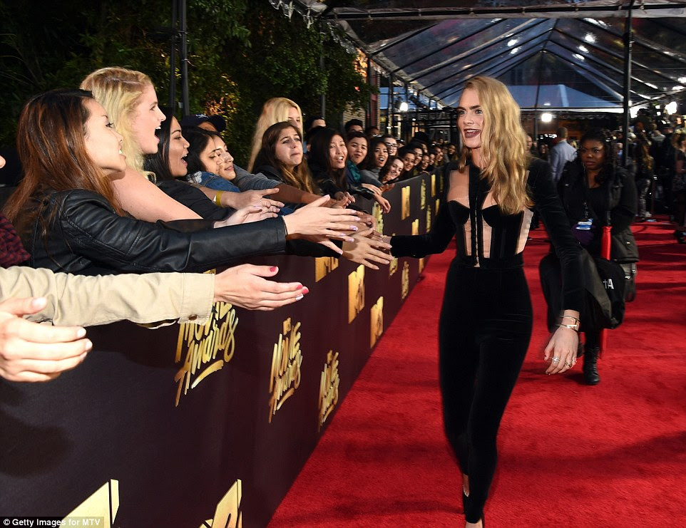High fives! The Brit beauty was in great spirits as she greeted some fans