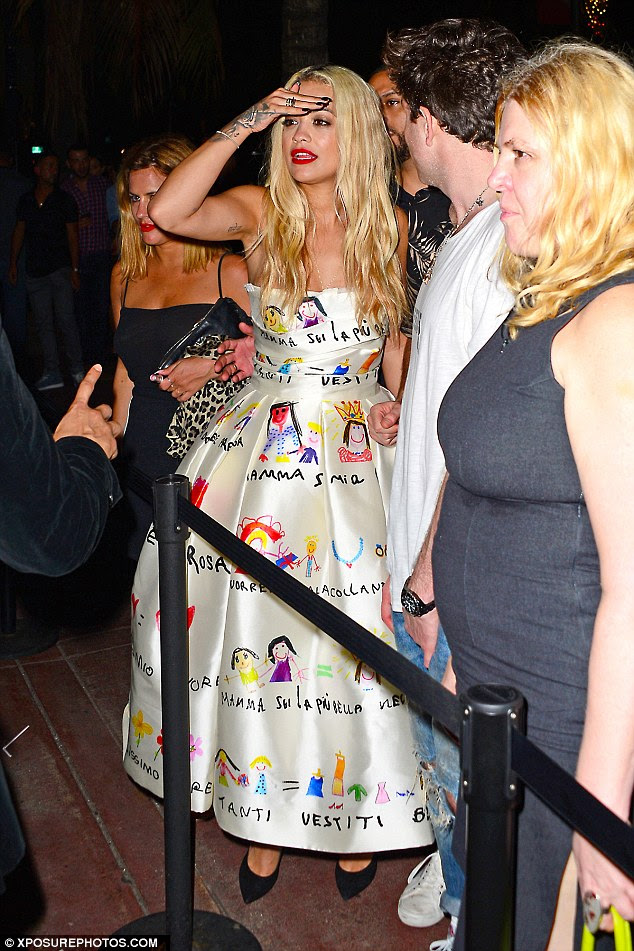 Standing out: Rita was hard to miss in her bright dress while Caroline showed off her tan in her strappy number