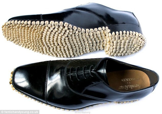 No need to panic: Designers Mariana Fantich and Dominic Young emphasise that the pearly whites inlayed into the Savile Row shoes are plastic dentures and not human