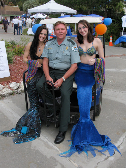 Tommy Ervin, park manager, and two mermaids at Weeki Wachee Springs, Florida