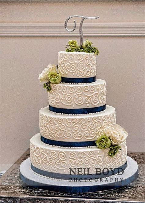 White and navy blue wedding cake. Wedding cake topper