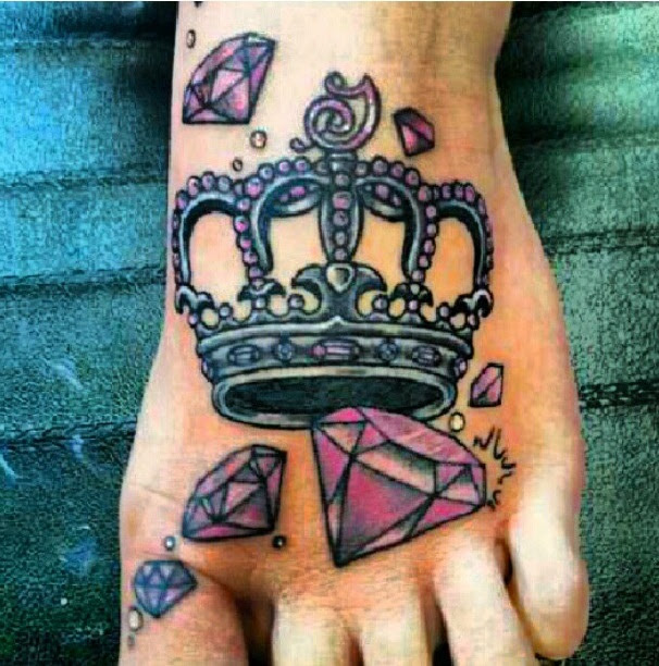 Purple Diamond And Crown Tattoo On Left Foot