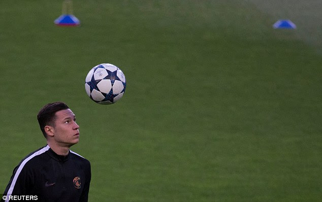 Germany international Julian Draxler attempts to bring the ball under his control
