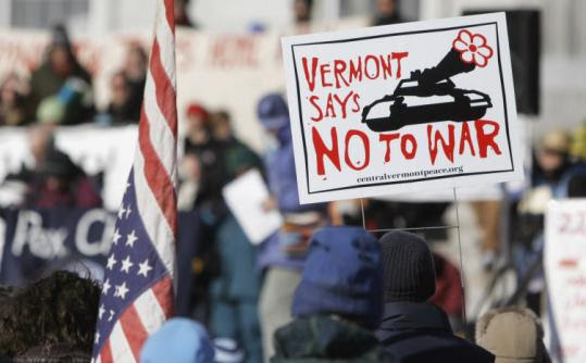 An antiwar protester held a sign during a rally at the State House in Montpelier in February 2006.