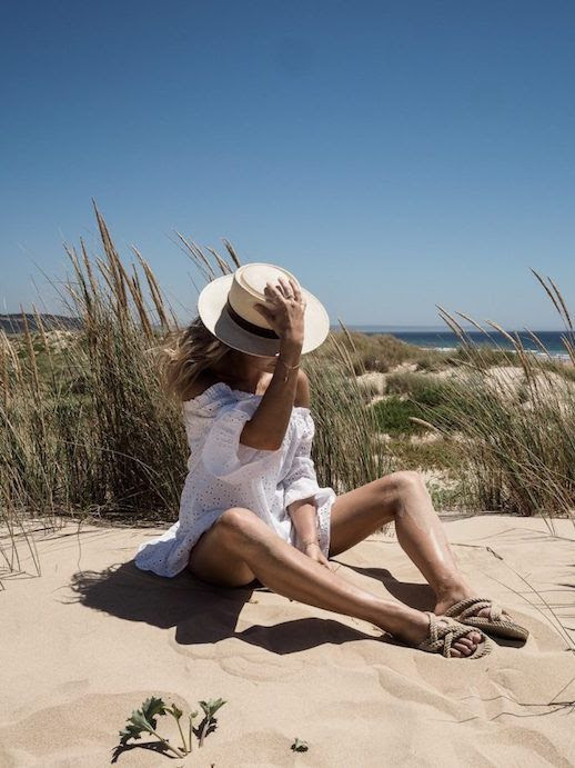 Le Fashion Blog What 3 Fashion Bloggers Wore To The Beach Eyelet White Dress Rope Sandals Hat Via Fashion Me Now