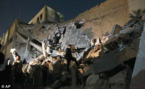 Target: Nato sorties have already attacked the compound of Gaddafi , such as these which struck during a raid in March