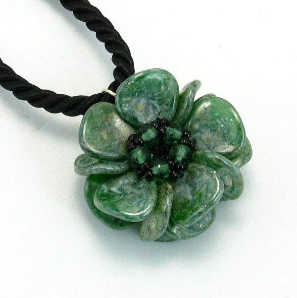 Green goes with everything, think about nature's pallet. You will be reaching for this necklace more often than not. Choose between three chain lengths, and select the one that is just right for you. The petals are Czech glass rose petal beads, and I've accented the petals with Japanese seed beads and coordinating Czech fire polish beads. $58.00