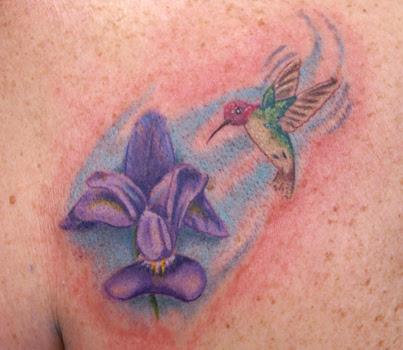 tattoo of a hummingbird tattoo of a dragon