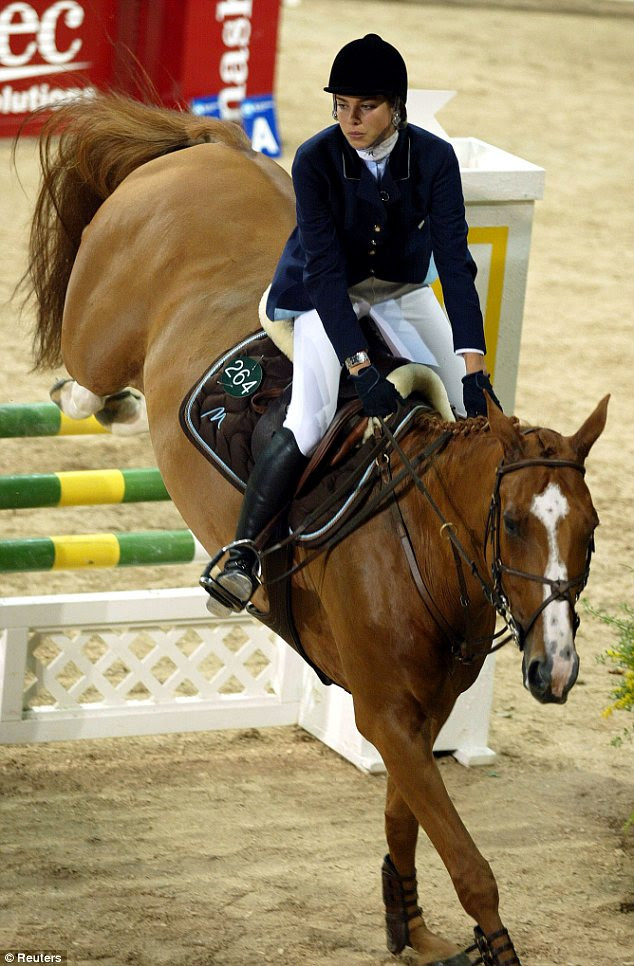 Skills: The Royal beauty is also an amateur show jumper, seen riding one of her horses above in 2002