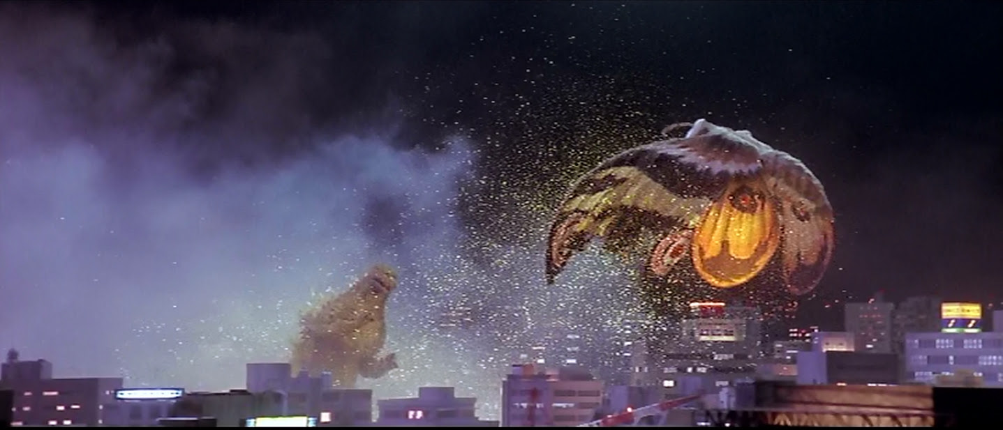 Mothra, using her poisonous scales.