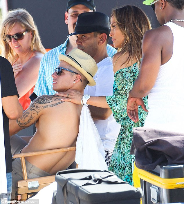 Keeping the spark alive: Jennifer massages boyfriend Casper Smart during a break in filming