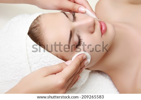 Young beautiful woman receiving facial massage and spa treatment