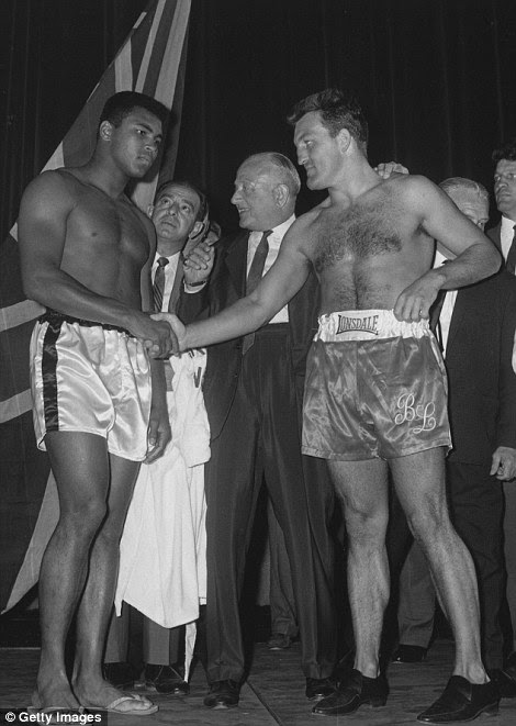 Ali (left) shakes hands with London before their 1966 fight at Earl's Court