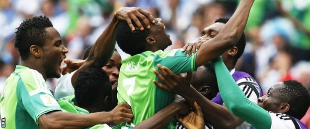 Ahmed Musa (centre) celebrates his second goal