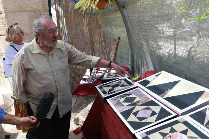 Dr. Gabriel Barkay, co-founder and director of the Temple Mount Sifting Project in presentation of the restored tiles of the Second Temple during Herodian Rule
