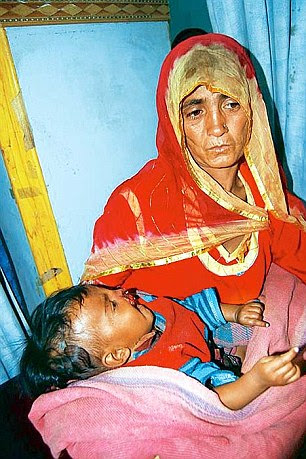 Santosh with her five-month-old daughter Radha