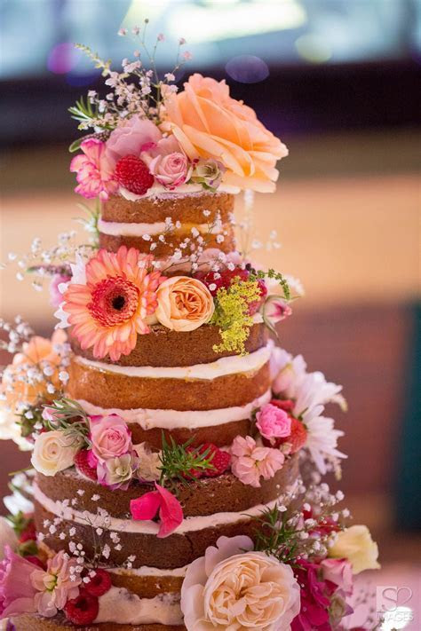 A floral 'naked' wedding cake by Victoria's Sponge in