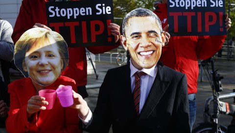 Protesters wear masks of U.S. President Barack Obama and German Chancellor Angela Merkel as they demonstrate against Transatlantic Trade and Investment Partnership (TTIP) free trade agreement before the opening ceremony of the Hannover Messe in Hanover, G