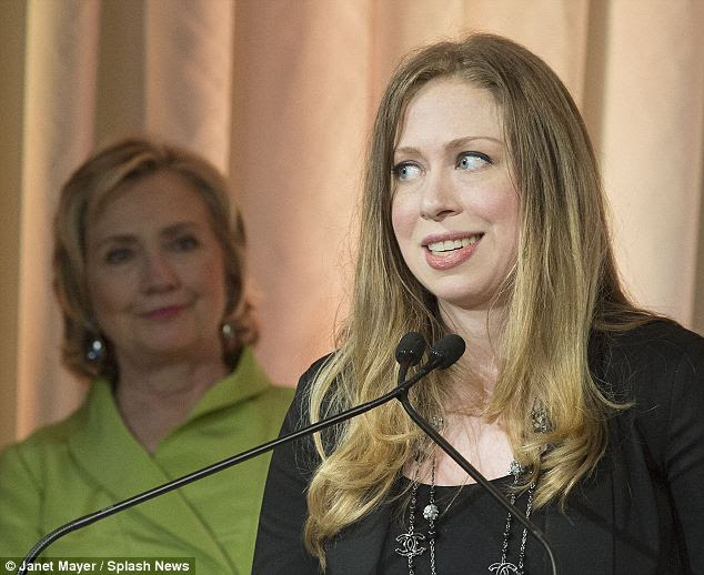 Earning her keep: Chelsea switched from an annual to a month-to-month contract earlier this year (pictured with her mother watching over her at a function n New York City on Thursday)