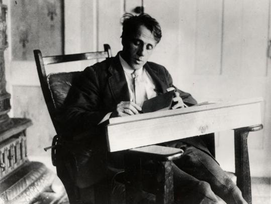 Poet Robert Frost (shown here circa 1915) made his first foray into teaching at Methuen's Second Grammar School. The 1893 attendance register at right was handwritten and signed by Frost. Restoration work on the document (below) is nearly complete.