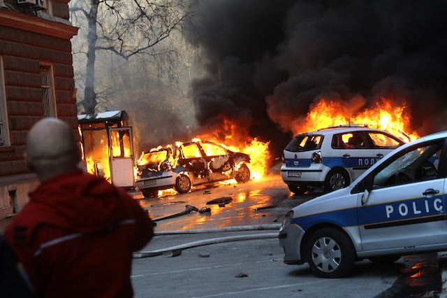 UNREST IN SARAJEVO. People watch police vehicles set ablaze during a demonstration in Sarajevo, Bosnia-Herzegovina, 07 February 2014. Dzenan Krijestorac/EPA