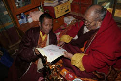 H.H. Dharma King Omniscience Achuk Lama stamps his second fingerprint onto the recognition letter he wrote recognizing the identity of H.H. Dorje Chang Buddha III