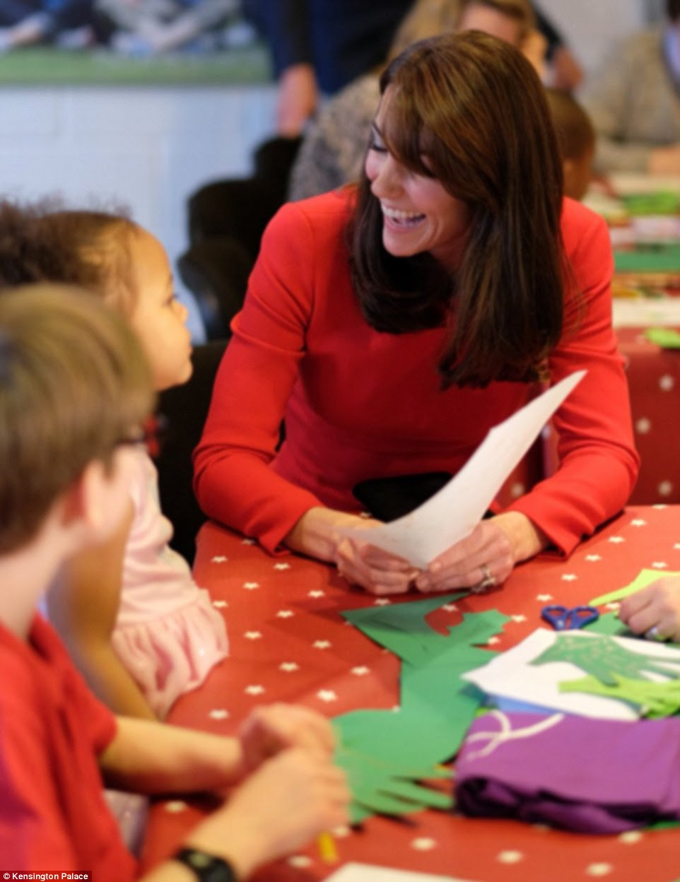 The Duchess of Cambridge appeared in high spirits as she laughed along with the children while making a Christmas tree collage