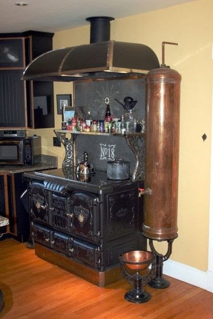 After ten minutes of drooling and wishing I had that stove, it finally hit me.  Is that awesome copper tank a DOG WATERER?  That is nearly as awesome as the stove.