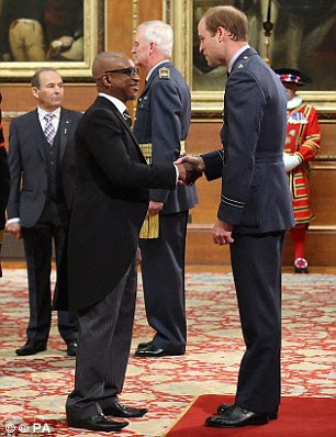 Honoured: It comes just weeks after the singer, who achieved a number one hit in 1988 with Don't Turn Around, was presented with an MBE by Prince William at Windsor Castle, pictured above