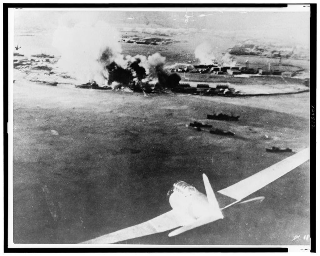 Aerial photograph, taken by a Japanese pilot, of the destruction of Pearl Harbor, Japanese bomber in lower right foreground. (Photo: Library of Congress Prints and Photographs)
