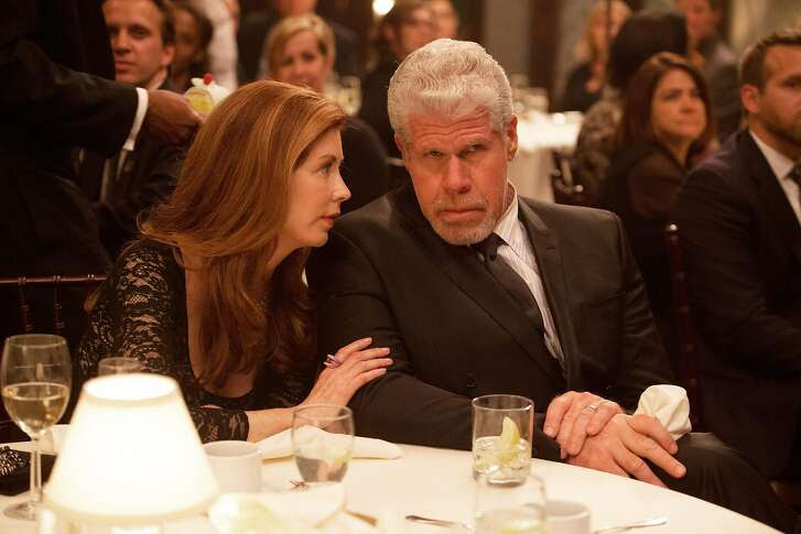 "This image provided by Amazon Studios shows Dana Delany, left, and Ron Perlman in a sceen from ""Hand of God."" The gutsy drama, which centers on ""Sons of Anarchy"" and ""Hellboy"" star Ron Perlman as a judge who believes God is guiding him after his family is attacked, is among the latest batch of potential series that'll be streamed online beginning Aug. 28 by Amazon. (AP Photo/Amazon Studios, Karen Ballard)"