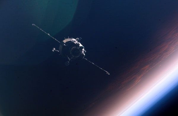 A manned Russian Soyuz spacecraft, as seen by a crewmember onboard the International Space Station.