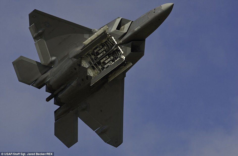 Weapons: An F-22 Raptor displays its weapons bays to the crowd during the Arctic Thunder Open House at Joint Base Elmendorf-Richardson, Alaska. Arctic Thunder, a biennial event, features more than 40 Air Force, Army and civilian aerial acts and is the largest two-day event in the state