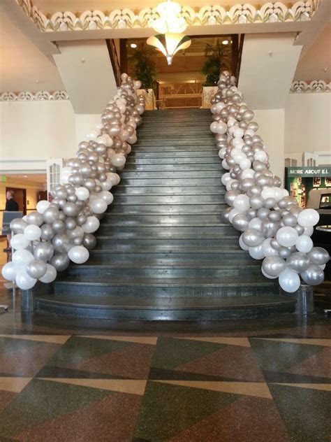 stair way treatment with white and silver balloons Great