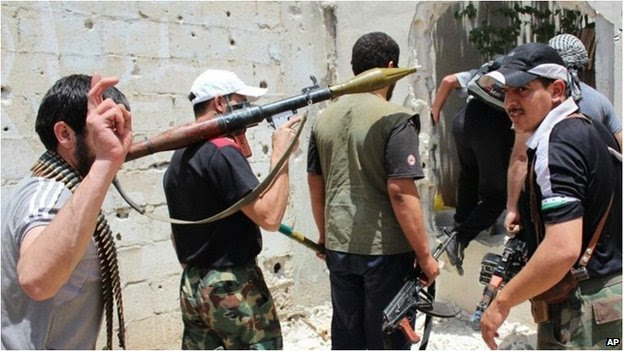 A group of armed anti-government fighters in Syria