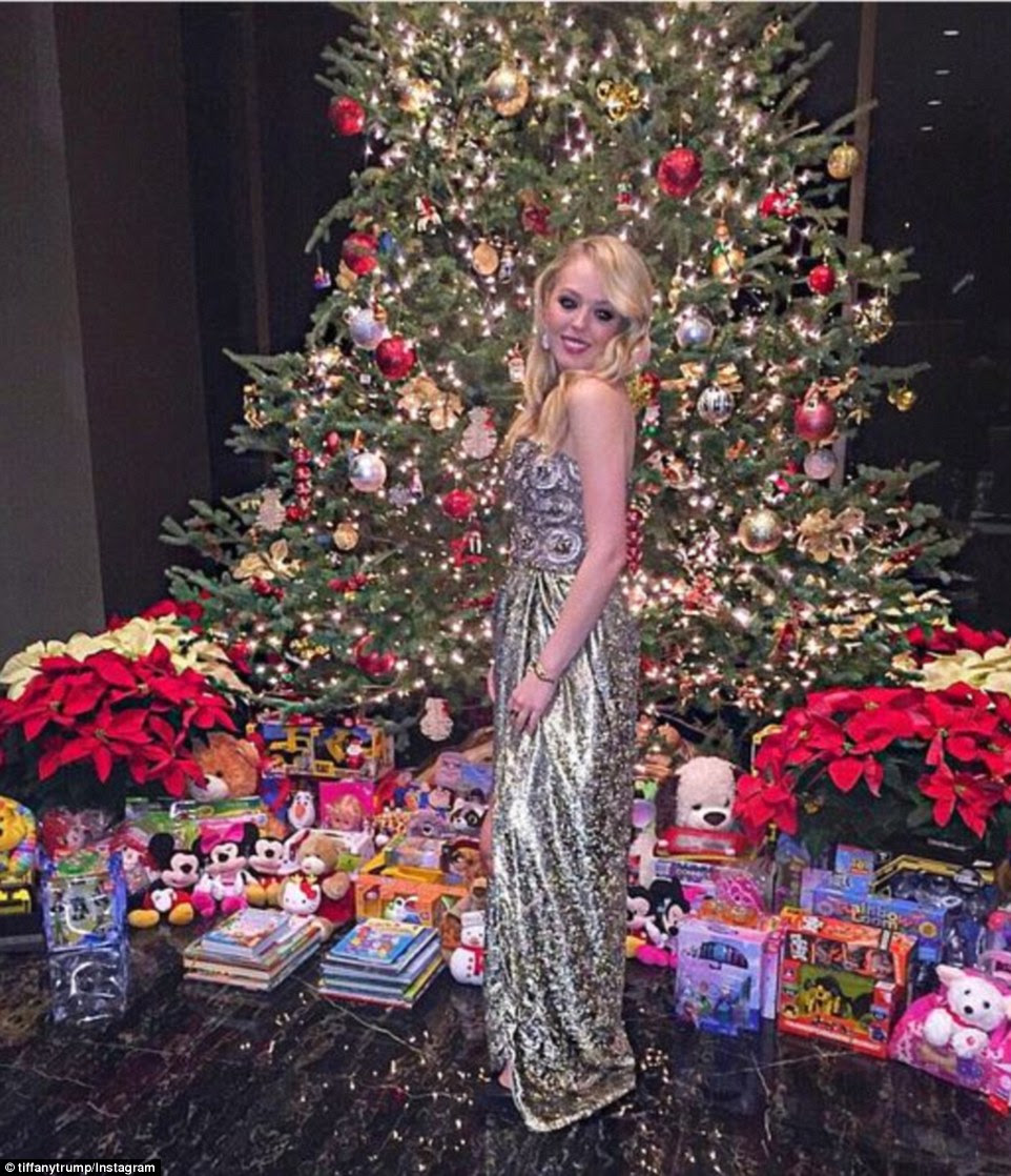 Tiffany Trump, daughter of GOP presidential candidate frontrunner Donald Trump, spent her Christmas in New York, posing in front of a massive Christmas tree surrounded by gifts
